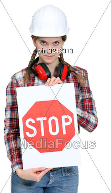Worker Holding A Stop Sign Stock Photo