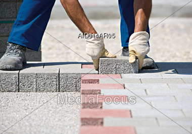 Worker Laying Brick Pavement Stock Photo