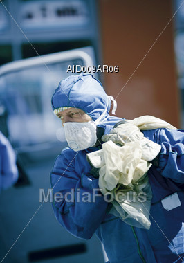 Worker Removing Hazardous Material Stock Photo