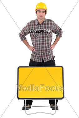 Worker Stood By Blank Road Sign Stock Photo
