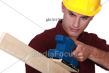 Worker With An Electric Sander Stock Photo