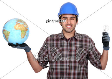 Worker With Bulb And Globe Stock Photo