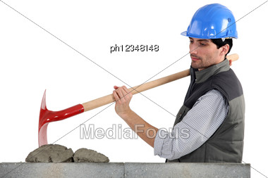 Worker With Spade And Cement Stock Photo