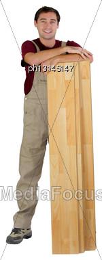 Worker With Wooden Floorboards Stock Photo