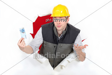 Workers Coming Out Of Torn Paper Hole With Ticket In Hand Stock Photo