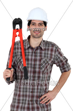 Workers With Tongs Stock Photo