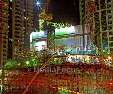 Working on construction site in the night Stock Photo