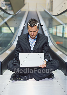 Working on His Laptop Stock Photo