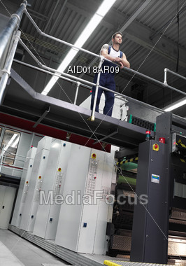 Worried Printing Plant Worker Stock Photo