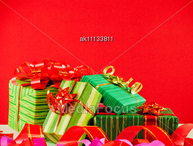 Wrapped Boxes With Presents Against Red Background Stock Photo