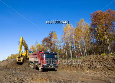 Yellow Backhoe And Truck. Stock Photo