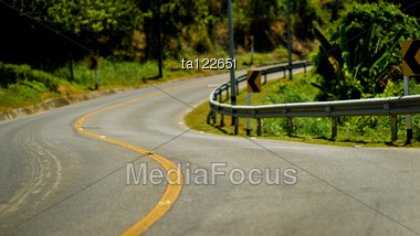 Yellow Dividing Line On The Turning Road Stock Photo