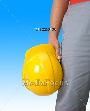 Yellow Helmet At Man Hands Isolated On A White Stock Photo