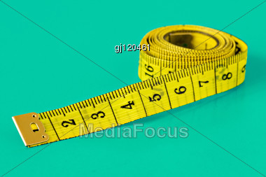 Yellow Measuring Tape On Light Blue Background Stock Photo