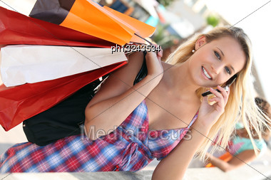 Youg Busy Woman Shopping Stock Photo