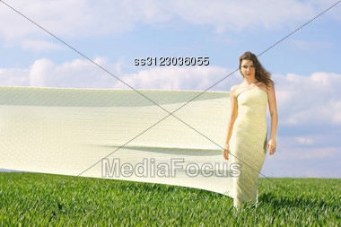 Young Attractive Woman In A Green Field Stock Photo