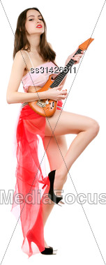 Young Attractive Woman Wearing Short Red Skirt And Playing The Toy Guitar. Isolated On White Stock Photo