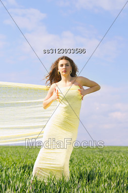 Young Attractive Woman Wrapped In Yellow Cloth Stock Photo