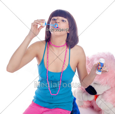 Young Beautiful Brunette And Soap Bubble On White Stock Photo