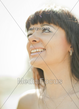 Young beautiful girl in sunny summer day Stock Photo