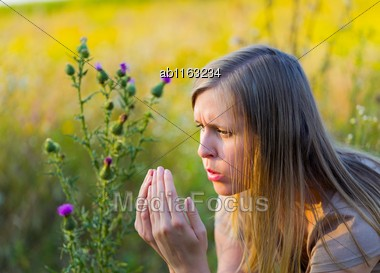 Young Beautiful Woman With Seasonal Illness Sneezing Because Of Pollen Stock Photo