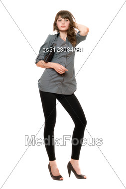 Young Beautiful Woman With A Black Handbag Stock Photo
