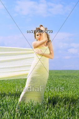Young Beautiful Woman Wrapped In Yellow Cloth Stock Photo