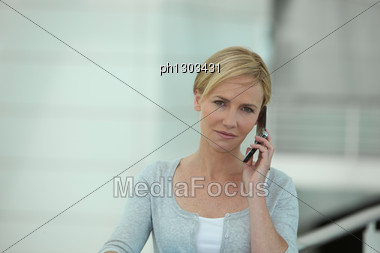 Young Blond Woman On The Phone Stock Photo