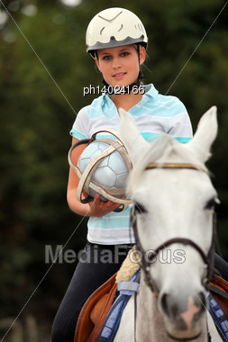 Young Blond Woman Playing Horse Ball Stock Photo