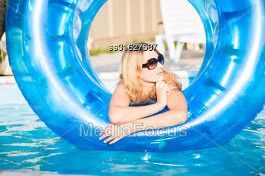 Young Blond Woman Posing In Rubber Ring Stock Photo