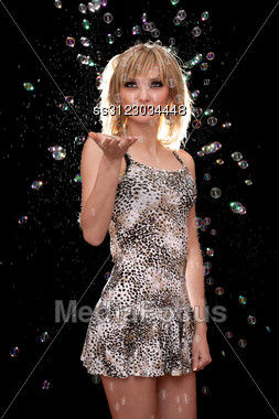 Young Blonde On Background Of A Soap Bubbles Stock Photo