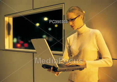Young Blonde Geek with Laptop Stock Photo
