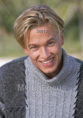 Young Blonde Man Smiling Stock Photo