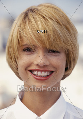 Young Blonde Woman with Big Smile Stock Photo
