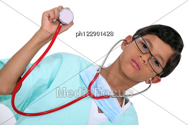 Young Boy Dressed As A Medic With A Stethoscope Stock Photo