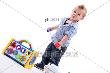 Young Boy Playing With A Shape Sorting Toy Stock Photo
