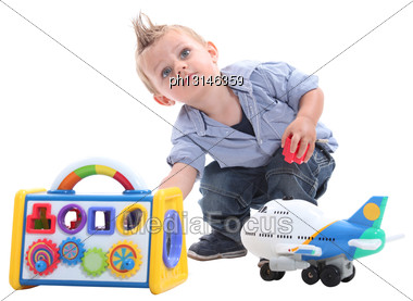 Young Boy Playing With Toys In A Studio Stock Photo