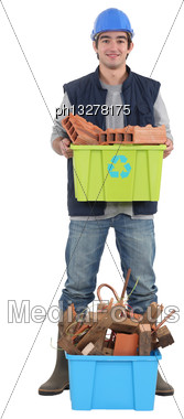Young Bricklayer Holding Recycling Tub Stock Photo