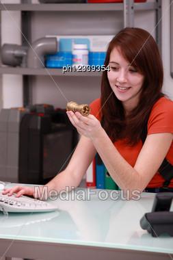 Young Brunette In Plumbing Shop Stock Photo