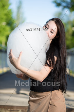 Young Brunette Posing With A Cotton Candy Stock Photo