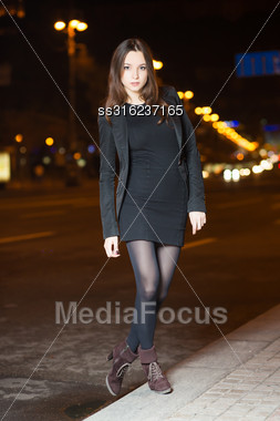 Young Brunette Wearing Black Clothes Posing Near The Road Stock Photo