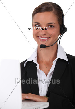 Young Brunette With Headphones And Microphone Stock Photo