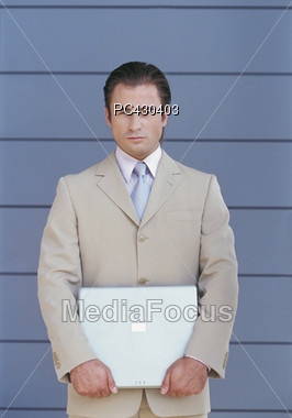 Young Business Man Holding Laptop Stock Photo