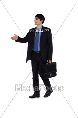 Young Businessman Giving His Hand For A Handshake Stock Photo