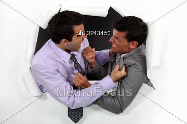 Young Businessmen Arguing Stock Photo