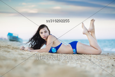 Young Caucasian Woman Posing At The Seaside Stock Photo