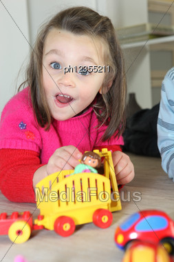 Young Child Playing With Her Toys Stock Photo