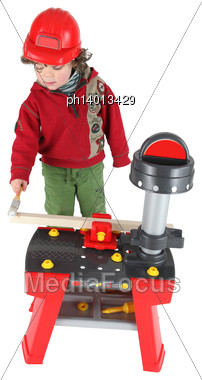 Young Child Pretending To Be A Carpenter Stock Photo