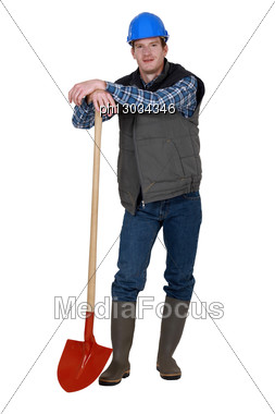 Young Construction Worker With A Shovel Stock Photo