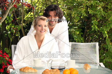 Young Couple Having Breakfast Outdoors Stock Photo